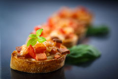 Bruschetta with cheese and tomatoes Stock Photos