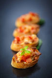 Bruschetta with cheese and tomatoes Stock Photography