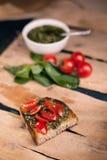 Bruschetta with cherry tomato and herb pesto Stock Image