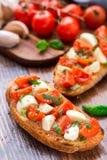 Bruschetta with cherry tomato and mozzarella Royalty Free Stock Image