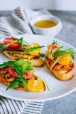 Bruschetta with cherry tomato salad with grilled haloumi cheese, stock photo