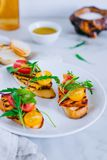 Bruschetta with cherry tomato salad with grilled haloumi cheese, stock photography