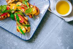 Bruschetta with cherry tomato salad with grilled haloumi cheese stock photos
