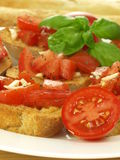 Bruschetta and cherry tomatoes Royalty Free Stock Photo