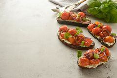 Bruschetta with cherry tomatoes and cheese cream. Healthy, vegan food, snack. Bruschetta with cherry tomatoes and cheese cream. Healthy, vegan food, bright royalty free stock photography