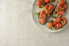 Bruschetta with cherry tomatoes and cheese cream. Healthy, vegan food, snack. Bruschetta with cherry tomatoes and cheese cream. Healthy, vegan food, bright royalty free stock images