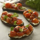 Bruschetta with cherry tomatoes and cheese cream. Healthy, vegan food, snack. Bruschetta with cherry tomatoes and cheese cream. Healthy, vegan food, bright stock photos