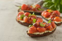 Bruschetta with cherry tomatoes and cheese cream. Healthy, vegan food, snack. Bruschetta with cherry tomatoes and cheese cream. Healthy, vegan food, bright royalty free stock photo