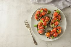 Bruschetta with cherry tomatoes and cheese cream. Healthy, vegan food, snack. Copy space. Bruschetta with cherry tomatoes and cheese cream. Healthy, vegan food royalty free stock photos