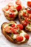 Bruschetta with cherry tomatoes, mozzarella cheese and herb pesto Royalty Free Stock Photo