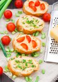 Bruschetta with cherry tomatoes and scallion Stock Images