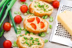 Bruschetta with cherry tomatoes and scallion Royalty Free Stock Photography