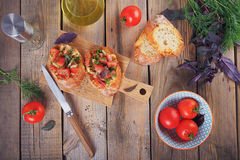 Bruschetta with chopped tomatoes, basil and herbs on grilled cru. Italian bruschetta with chopped tomatoes, basil, herbs and olive oil on grilled crusty bread Stock Image