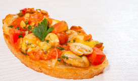 Bruschetta with chopped vegetables, herbs, cheese and mushroom on toasted crusty ciabatta bread Stock Photography
