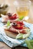Bruschetta con el jamón de Parma Imagen de archivo