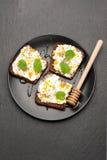 Bruschetta with cream cheese, chia seeds and honey. Royalty Free Stock Photo