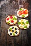 Bruschetta with cream cheese, fresh berries, chia seeds and honey. Stock Images