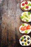 Bruschetta with cream cheese, fresh berries, chia seeds and honey. Royalty Free Stock Photography