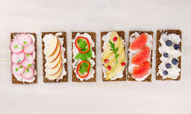 Bruschetta with cream cheese and fresh berries, fruits and veget Stock Images