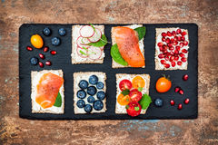 Bruschetta Crostini Appetizers Mix Set With Various Toppings. Variety Of Small Sweet And Sour Breakfast Sandwiches Royalty Free Stock Photography