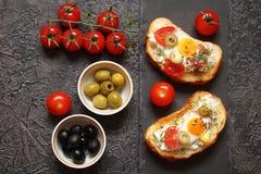 Bruschetta, crostini with cream cheese, with cherry tomatoes, he Stock Photos
