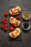 Bruschetta, crostini with cream cheese, with cherry tomatoes, he Royalty Free Stock Photo