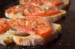 Bruschetta on dark tray Stock Images