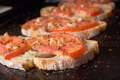 Bruschetta on dark tray. At shallow depth of field Royalty Free Stock Photos