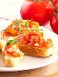 Bruschetta de los tomates y de Ruccola Imágenes de archivo libres de regalías