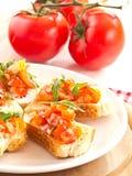 Bruschetta de los tomates y de Ruccola Fotografía de archivo
