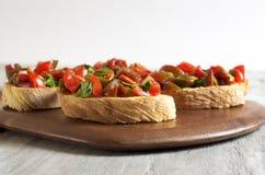 Bruschetta del prezzemolo e del pomodoro Fotografie Stock