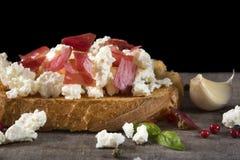 Bruschetta del queso y de la carne Imagen de archivo libre de regalías