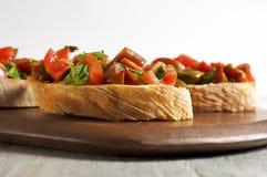 Bruschetta del tomate y del perejil Imágenes de archivo libres de regalías