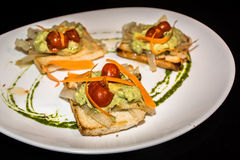 Bruschetta dell'avocado Fotografie Stock