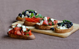 Bruschetta with different fillings Royalty Free Stock Photography