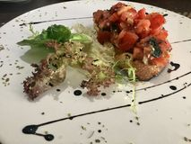 Bruschetta dish - fancy display. Bruschetta is an antipasto & x28;starter dish& x29; from Italy consisting of grilled bread rubbed with garlicand topped with Stock Image