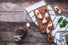 Bruschetta with figs on chopping board in rustic style Royalty Free Stock Photography