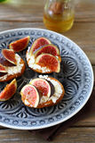 Bruschetta with figs on a plate Stock Images