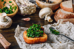 Bruschetta with Fresh Italian Herbs Mix. And Some Ingredients on Background stock photography