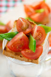 Bruschetta with fresh tomato and snow peas Royalty Free Stock Photography