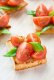 Bruschetta with fresh tomato and snow peas Stock Photos