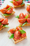Bruschetta with fresh tomato and snow peas Stock Image