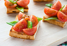 Bruschetta with fresh tomato and snow peas Royalty Free Stock Photo
