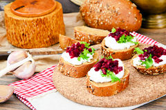 Bruschetta with Goat Cheese, Arugula and Beet Royalty Free Stock Images