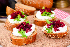 Bruschetta with Goat Cheese, Arugula and Beet Stock Images
