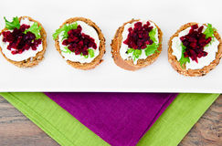 Bruschetta with Goat Cheese, Arugula and Beet Royalty Free Stock Photography