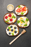 Bruschetta with goat cheese, honey and fresh berries. top view Stock Photo