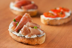 Bruschetta with goat cheese and prosciutto Stock Photography