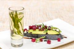 Bruschetta with Gorgonzola, avocado and beetroot Stock Photos