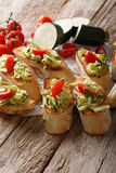 Bruschetta with grated zucchini, oregano and tomatoes close-up. Stock Image